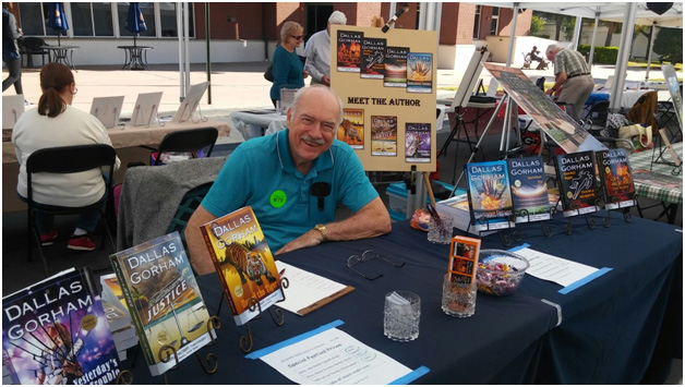 Dallas Signing Books at the Leesburg Art Fest